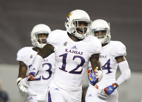 Kansas cornerback Dexter McDonald celebrates his interception during the fourth quarter on Saturday, Sept. 14, 2013 at Rice Stadium in Houston, Texas.