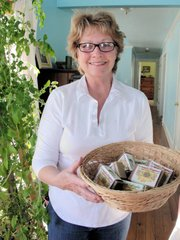 Carolyn Reid holds a basket of Carolyn's Natural Soap, which she makes at her Perry ranch with help from daughter Julie Justus.