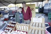 Courtney Skeeba and her son, Marek, sell the handcrafted goat butter soaps they make at their home, Homestead Ranch of Lecompton, at the Lawrence Farmers Market.