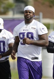 Minnesota Vikings defensive tackle Christian Ballard makes his way to the field during NFL football training camp, July 29, 2013, in Mankato, Minn. Ballard, a former Free State High standout, left Vikings camp on Aug. 18 and revealed to USA Today in a story published Wednesday that he has retired from the NFL.