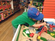 The Kid plays at the train table at the Toy Store, 936  Massachusetts St., during one of the stores regular Cub Clubs.