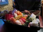 The sushi sashimi boat at Yokohama has a little bit of everything. Find Yokohama Sushi at 811 New Hampshire St., 785-856-8862, yokohamasushioflawrence.com.