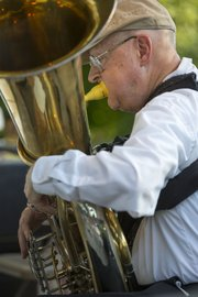 Dean Somerville, Lawrence, warms up on his tuba before the start of  the final Lawrence City Band concert of the summer, held Wednesday, July 17, 2013 at South Park.