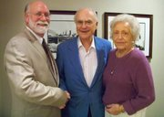 Mike Reid, left, public relations director for the Kansas Union, poses with James and Mary Ellen Ascher, who donated $130,000 to keep a 1,000-piece collection of historical Jayhawk memorabilia at the union.