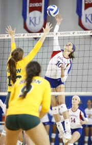 Kansas University freshman Tayler Soucie sends the ball back over the net against North Dakota State player Emily Miron during the second game on Friday, Sept. 20, 2013 at the Horejsi Center.