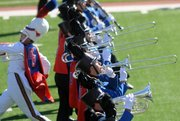 Kansas University's horn section works the field during Band Day at Memorial Stadium.