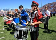 Austin Long, of the Anderson County Bulldog Band, joined the drum line during Band Day at Memorial Stadium. About 650 students from high schools across Kansas and Missouri took part.