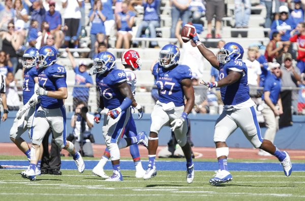 Kansas defensive lineman Keon Stowers comes away with the ball after recovering a Louisiana Tech fumble late in the fourth quarter to give the Jayhawks the ball back.