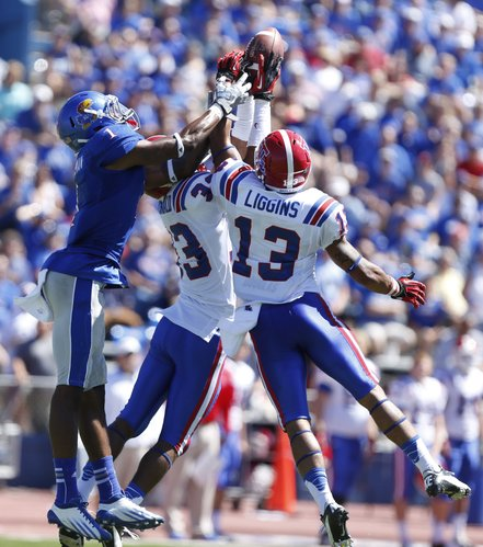 Kansas receiver Rod Coleman has a pass broken up by Louisiana Tech defenders Thomas McDonald (33) and Le'Vander Liggins (13) during the third quarter on Saturday, Sept. 21, 2013 at Memorial Stadium.