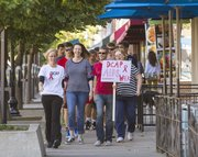 Walkers move down Massachusetts Street as they participate in the 23rd annual AIDS walk Sunday morning. The walk, sponsored by the Douglas County AIDS Project, featured a two mile course that passed through downtown Lawrence.