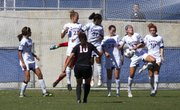 Kansas players form a wall as they block a kick by Illinois State's Kyla Cross (10) during their game Sunday afternoon at the Jayhawk Soccer Complex. The Jayhawks won 2-0.