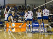 Kansas players celebrate a point in their game against Notre Dame Sunday afternoon at the Horejsi Center. The Jayhawks defeated the Fighting Irish in four sets.