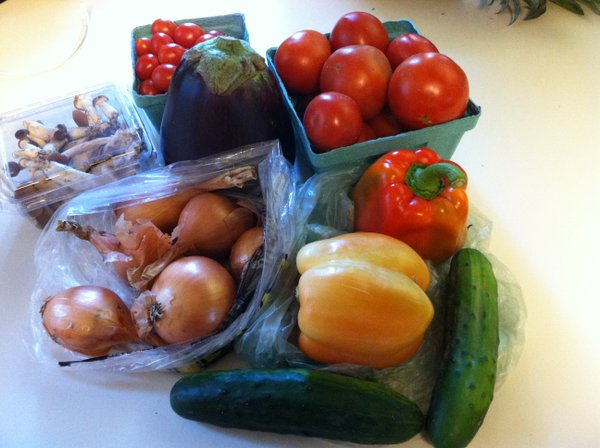 Slicing and grape tomatoes, cucumbers, mushrooms, eggplant, onions and peppers.