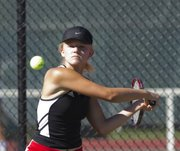 Lawrence High's Caroline Baloga sets up for a shot during a quad Monday, Sept. 23, 2013, at LHS.