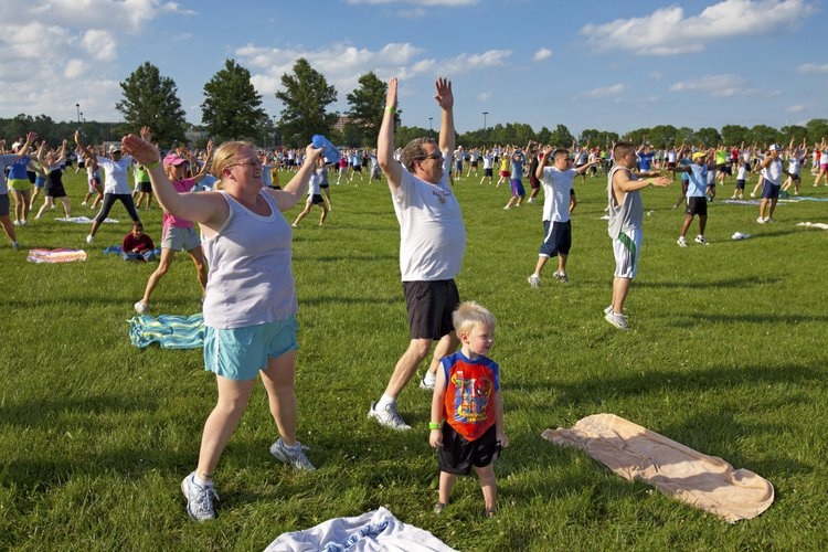 """LiveWell Lawrence organized the first """"World Largest Community Workout"""" in 2009 to promote physical activity and to raise awareness about its mission. The event drew hundreds of participants. A second workout was held in 2010."""