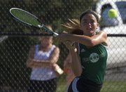 Free State junior Megan McReynolds hits a backhand during her singles match Wednesday at FSHS.
