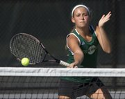 Free State junior Taylor Hawkins hits a volley at the net during her doubles match Wednesday at FSHS.