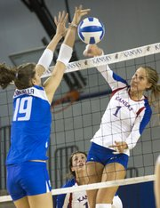 Kansas junior Chelsea Albers (1) is challenged at the net by Italy's Cristina Chirichella (19) during Kansas' game against Italy's Under 23 National Team Wednesday at the Horejsi Center. The Jayhawks lost in five sets.