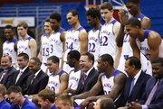 Kansas head coach Bill Self laughs with his team and assistant coaches as they gather together for the official team photo during Media Day on Wednesday, Sept. 25, 2013 at Allen Fieldhouse. Nick Krug/Journal-World Photo