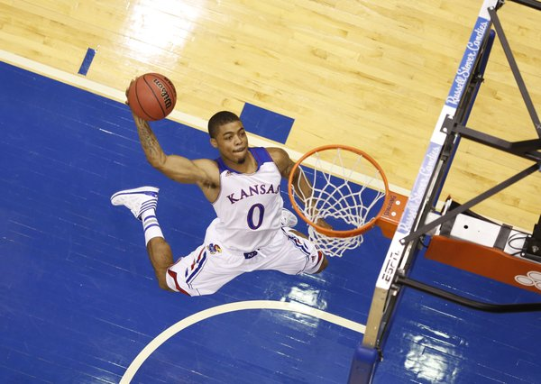 Kansas guard Frank Mason comes in for a jam as he and teammates shoot around while waiting for interviews during Media Day on Wednesday, Sept. 25, 2013 at Allen Fieldhouse. Nick Krug/Journal-World Photo