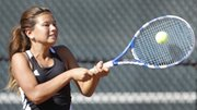 Lawrence High's Yelena Birt competes in a doubles match Thursday, Sept. 26, 2013, against Manhattan.