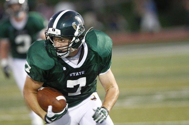 Free State senior wide receiver Blake Winslow (7) looks for running room against  Olathe East on Friday September 20, 2013