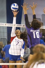 Kansas sophomore outside hitter Tiana Dockery (7) is challenged at the net by TCU's Mattie Burleson (16) during their volleyball match Saturday afternoon at the Horejsi Center.
