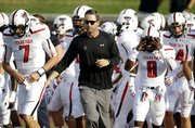 Texas Tech football coach Kliff Kingsbury runs on the field with his team before the Red Raiders' 41-23 victory over SMU on Aug. 30 in Dallas. Kingsbury, the former Tech and New England Patriots (backup) QB, will face Kansas at 11 a.m. Saturday at Memorial Stadium.