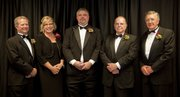 The 2013 Lawrence Business Hall of Fame recipients were honored Tuesday night at KU. From left are honorees Chuck Magerl, Karen and Curt Gerogeson, daughter and son of recipient Bob Georgeson, Dolph Simons Jr. and Sherry Schaub.