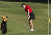 Lawrence High senior Abby Schmidtberger chips onto the green during the Lawrence High Golf Invitational, Tuesday, Oct. 1, 2013, at Alvamar Golf Course.