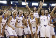 "The KU women&squot;s team yells ""Late Night"" for a film crew during the KU women&squot;s basketball team media day Wednesday at Allen Field House. The 29th-annual Late Night in the Phog will run from 6:30 p.m. to approximately 9:30 on Friday, Oct. 4"