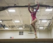 Lawrence High freshman Jordyn Leon performs her balance beam routine Wednesday at Free State.