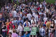 Zombies and humans alike gathered Thursday, October 3, 2013 for the annual Zombie Walk that started at South Park and travelled through Downtown Lawrence.