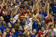 "Fans go wild during the ""Jawhaks in the NBA"" part of Late Night in the Phog Friday at Allen Fieldhouse."