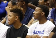 Kansas recruits Kelly Oubre, left, and King McClure watch from behind the bench during Late Night in the Phog, Friday, Oct. 4, 2013 at Allen Fieldhouse.