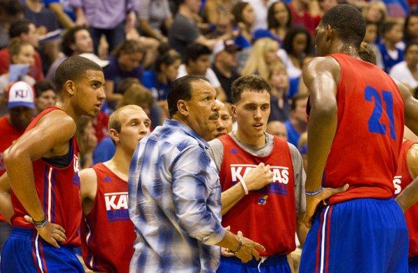 Coach Kurtis Townsend huddles with the red team during a timeout in the men's basketball scrimmage during Late Night in the Phog Friday at Allen Fieldhouse.