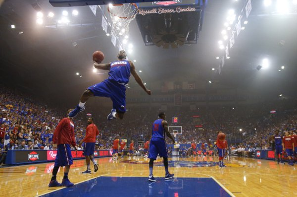Kansas freshman guard Wayne Selden soars in for a dunk during an unofficial dunk contest during warmups before a scrimmage.