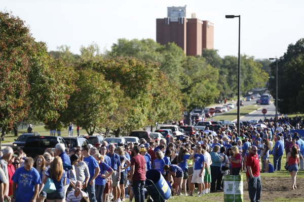 Scores of fans line up down Naismith Drive before the fieldhouse doors opened for Late Night in the Phog, Friday, Oct. 4, 2013.