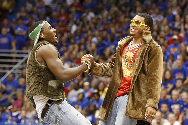 Wayne Selden is helped up by Niko Roberts as the two dance to a Macklemore song during the skits and performances portion of Late Night in the Phog, Friday, Oct. 4, 2013 at Allen Fieldhouse.