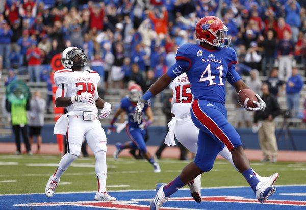 Kansas tight end Jimmay Mundine strolls into the endzone for a touchdown against Texas Tech during the first quarter on Saturday, Oct. 5, 2013 at Memorial Stadium.