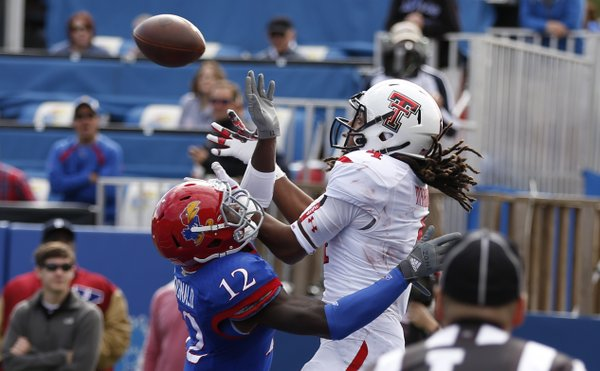 Kansas cornerback Dexter McDonald gets called for interference on an endzone pass to Texas Tech receiver Bradley Marquez during the second quarter on Saturday, Oct. 5, 2013 at Memorial Stadium.