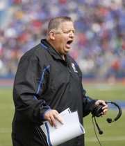 Kansas head coach Charlie Weis disputes a call during the second quarter on Saturday, Oct. 5, 2013 at Memorial Stadium.