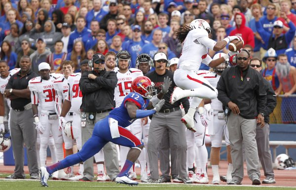 Kansas cornerback Dexter McDonald forces Texas Tech receiver Bradley Marquez out of bounds to force a fourth down during the first quarter on Saturday, Oct. 5, 2013 at Memorial Stadium.