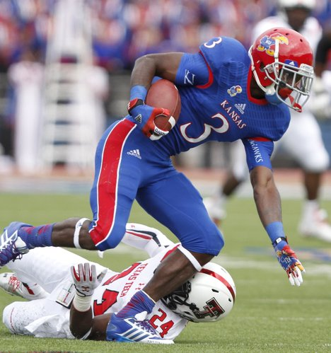 Kansas running back Tony Pierson shakes Texas Tech defensive back Bruce Jones during the first quarter on Saturday, Oct. 5, 2013 at Memorial Stadium.