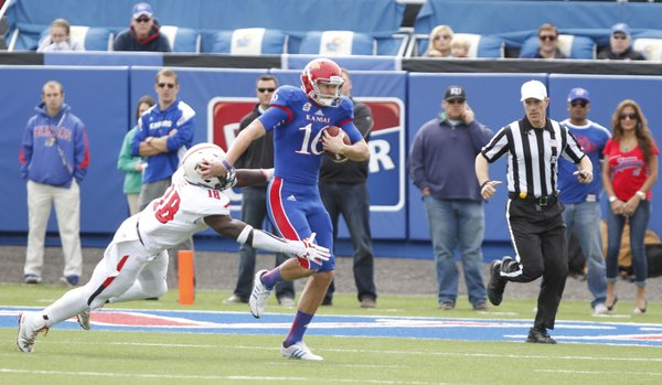 Kansas punter Trevor Pardula takes off on a fourth-down run on a fake punt against Texas Tech during the second quarter on Saturday, Oct. 5, 2013 at Memorial Stadium. Pardula was stopped on the play by Tech linebacker Micah Aw to give the Red Raiders the ball deep in Jayhawk territory.