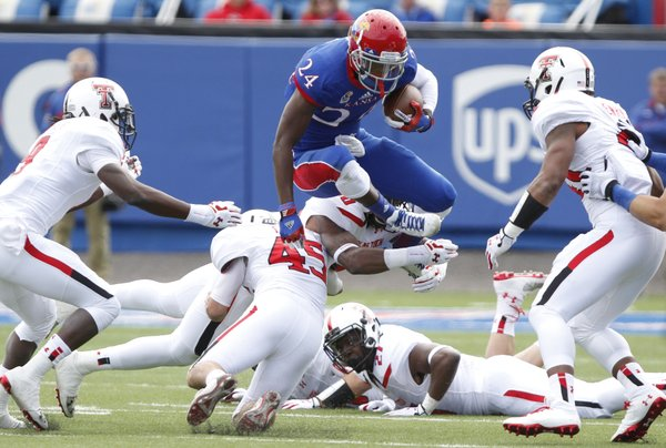 Kansas kick returner JaCorey Shepherd looks to hurdle a Texas Tech special teams play during a return in the second quarter on Saturday, Oct. 5, 2013 at Memorial Stadium.