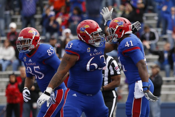 Kansas tight end Jimmay Mundine (41) celebrates his first-quarter touchdown with offensive lineman Ngalu Fusimalohi against Texas Tech on Saturday, Oct. 5, 2013 at Memorial Stadium.