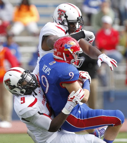 Kansas quarterback Jake Heaps is sacked by Texas Tech linebacker Brandon Jackson during the third quarter on Saturday, Oct. 5, 2013 at Memorial Stadium.