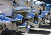 Cadillacs donning dagmar bumpers are shown at an antique car show at the Douglas County Fairgrounds Sunday. The term 'dagmar' is used to described the bullet shaped points sticking out on the bumpers, referencing a 1950s pinup girl by the name Dagmar.