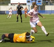 Texas goal keeper Abby Smith (1) pulls the ball away from Kansas' Caroline Kastor (10) during their soccer match Sunday afternoon at the Jayhawk Soccer Complex. The Jayhawks fell to the Longhorns, 1-0.